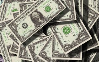 Трейдеры массово скупают доллары благодаря высокой доходности гособлигаций США