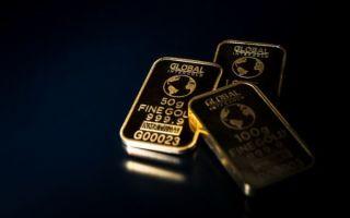 Золото продолжает дорожать на фоне снижения курса доллара
