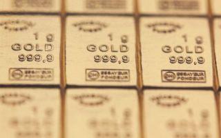 Золото торгуется в районе недельного минимума