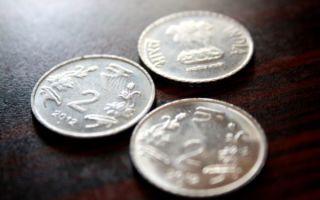 Индийская рупия закрыла торги ростом к доллару